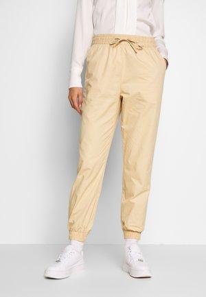 PAM TROUSERS - Bukse - beige