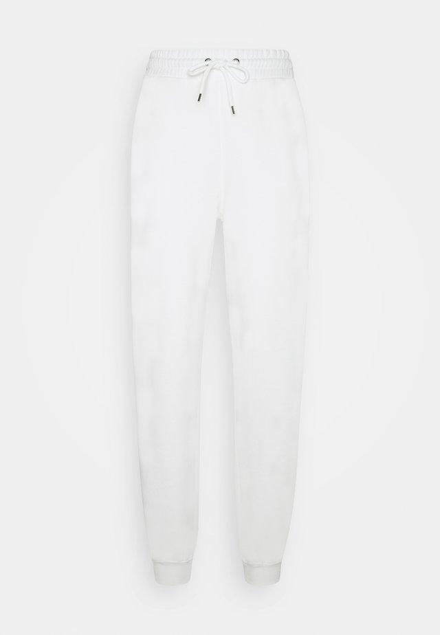 KARDI PANTS - Tracksuit bottoms - white light