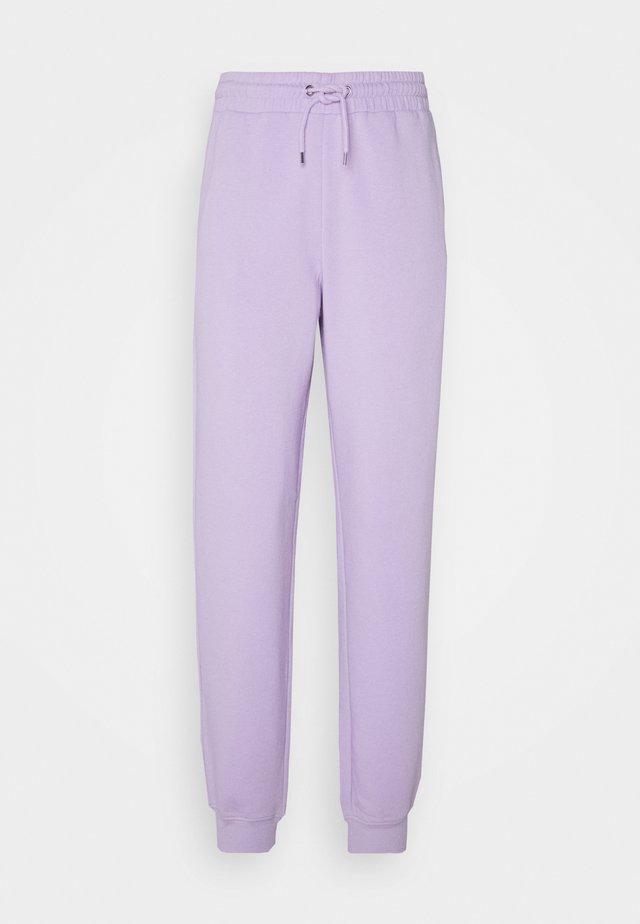 KARDI PANTS - Tracksuit bottoms - lilac