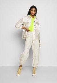 Monki - SUM TROUSERS - Trousers - beige dusty - 1