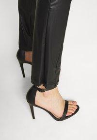 Monki - FINLEY TROUSERS - Trousers - black - 6