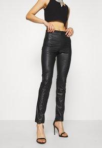 Monki - FINLEY TROUSERS - Trousers - black - 0