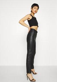 Monki - FINLEY TROUSERS - Trousers - black - 4