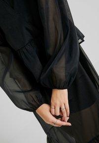 Monki - JENNIFER DRESS - Freizeitkleid - organza black - 6