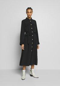 Monki - LIV UTILITY DRESS - Skjortekjole - black - 0