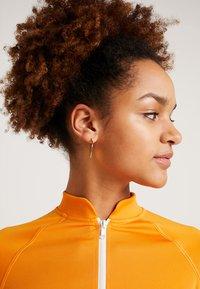 Monki - EZRA - T-shirts print - orange/white - 3