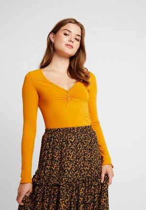PARADISIO - T-shirt à manches longues - dark yellow