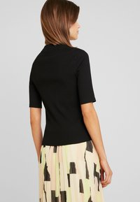 Monki - SABRINA - T-shirts - black dark solid - 2