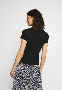 Monki - MAGDALENA TEE - T-shirts - black dark solid - 2