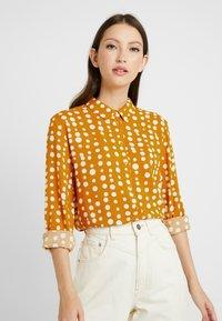 Monki - NADINA BLOUSE - Button-down blouse - yellow dark - 0