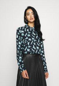 Monki - NADINA BLOUSE - Button-down blouse - dark blue - 0