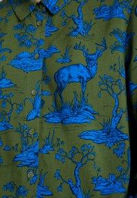 Monki - NADINA BLOUSE - Button-down blouse - blue - 5