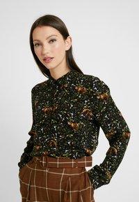 Monki - NADINA BLOUSE - Button-down blouse - green - 0