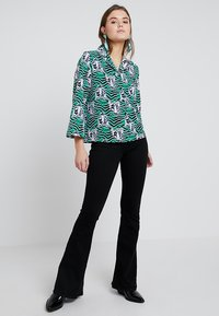 Monki - ANNELIE BLOUSE - Button-down blouse - green/black - 1