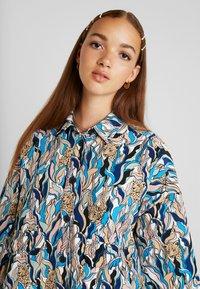 Monki - CATY BLOUSE - Button-down blouse - white - 3