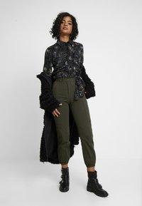 Monki - LOVA BLOUSE - Button-down blouse - black - 1