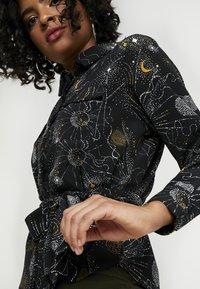 Monki - LOVA BLOUSE - Button-down blouse - black - 4