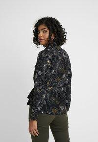 Monki - LOVA BLOUSE - Button-down blouse - black - 2