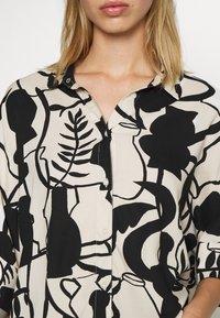 Monki - LUCA BLOUSE - Button-down blouse - beige - 5
