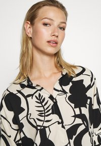 Monki - LUCA BLOUSE - Button-down blouse - beige - 3