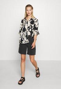 Monki - LUCA BLOUSE - Button-down blouse - beige - 1