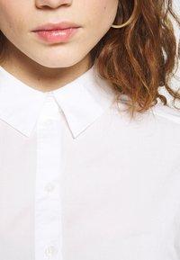 Monki - OFELIA BLOUSE - Bluser - white light solid - 5