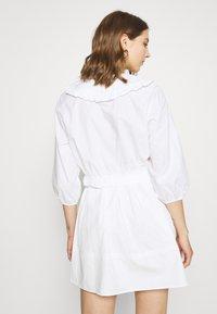 Monki - MILDA BLOUSE - Button-down blouse - white - 2
