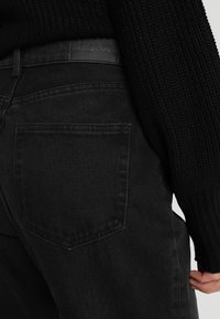 Monki - TAIKI  - Relaxed fit jeans - black - 3