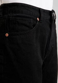 Monki - IKMO UNIQUE - Relaxed fit jeans - black - 5