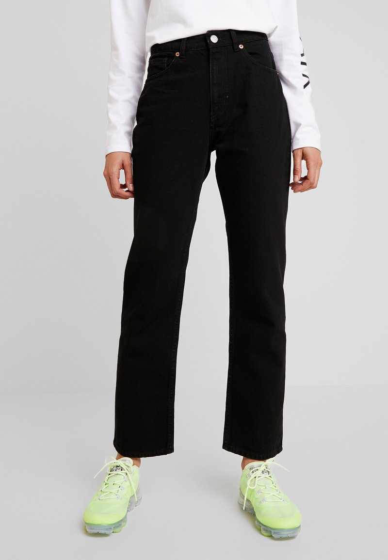 Monki - IKMO UNIQUE - Relaxed fit jeans - black