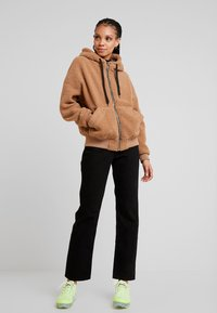 Monki - IKMO UNIQUE - Relaxed fit jeans - black - 1