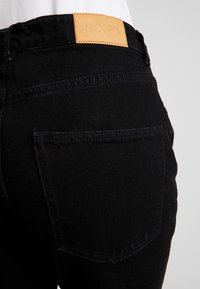 Monki - IKMO UNIQUE - Relaxed fit jeans - black - 3
