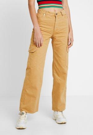 YOKO POCKET - Flared jeans - sandyellow/beige