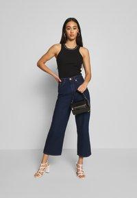 Monki - MOZIK RINSE - Jeans Relaxed Fit - blue medium dusty - 1