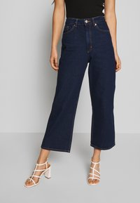 Monki - MOZIK RINSE - Jeans Relaxed Fit - blue medium dusty - 0