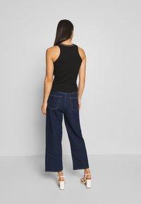 Monki - MOZIK RINSE - Jeans Relaxed Fit - blue medium dusty - 2