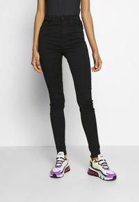 Monki - OKI BLACK DELUXE - Jeans Skinny Fit - black dark quick rinse - 0