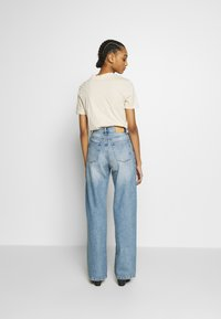 Monki - YOKO  - Jeans straight leg - blue medium dusty