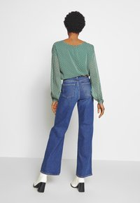 Monki - YOKO - Straight leg jeans - blue medium dusty