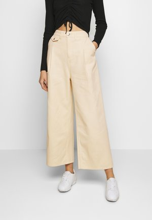 NANI TROUSERS - Flared Jeans - white light
