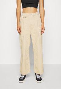 Monki - NANI TROUSERS - Flared Jeans - beige medium - 0