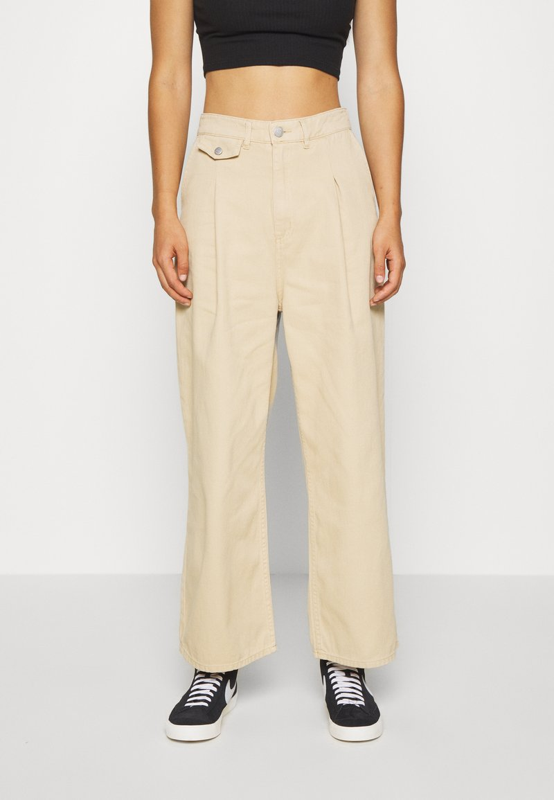 Monki - NANI TROUSERS - Flared Jeans - beige medium