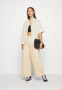 Monki - NANI TROUSERS - Flared Jeans - beige medium - 1