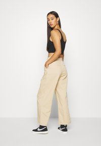 Monki - NANI TROUSERS - Flared Jeans - beige medium - 2