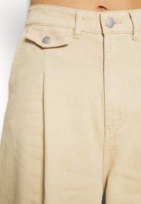 Monki - NANI TROUSERS - Flared Jeans - beige medium - 4