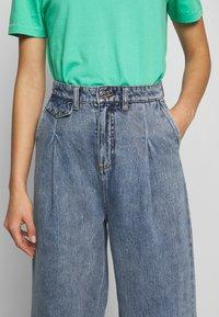 Monki - NANI TROUSERS - Flared jeans - blue medium dusty - 5