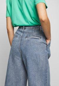 Monki - NANI TROUSERS - Flared jeans - blue medium dusty - 3