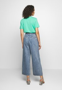Monki - NANI TROUSERS - Flared jeans - blue medium dusty - 2