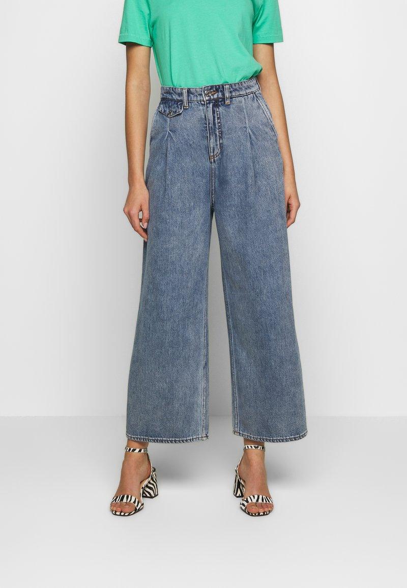 Monki - NANI TROUSERS - Flared jeans - blue medium dusty