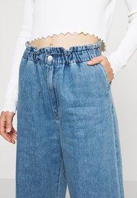 Monki - LIZETTE TROUSER - Relaxed fit jeans - blue medium - 3